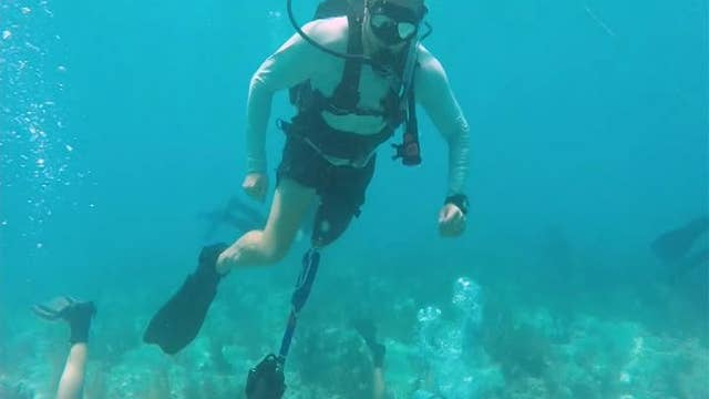 Wounded warriors help save dying coral reef