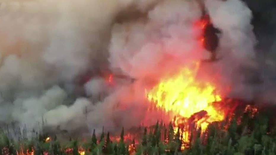 Crews battle wildfires across Western states