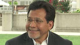 Alberto Gonzales reacts after House moves legislation forward