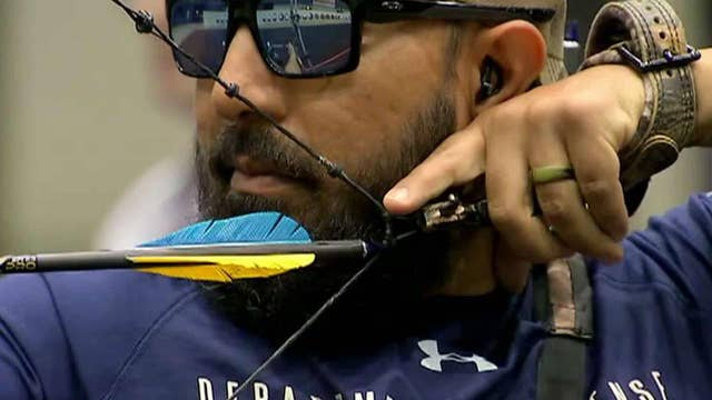 Blind veteran competes in archery at annual Warrior Games