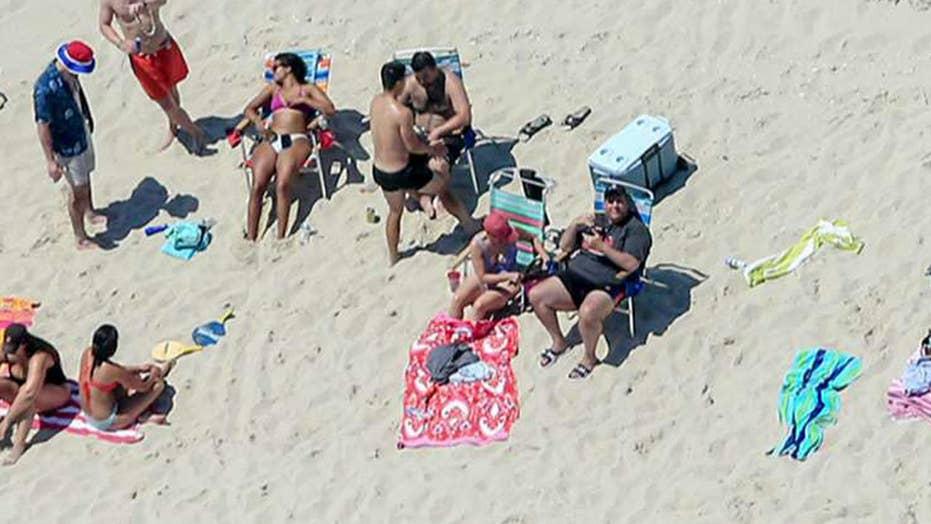 Firestorm over photo of Gov. Christie on closed NJ beach