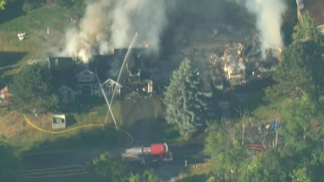 Firefighters battle house fire on Whidbey Island, Washington