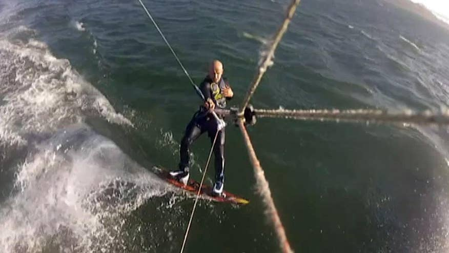 Kite boarder hits ocean speed bump