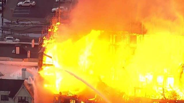 Firefighters battle structure fire in Oakland, California