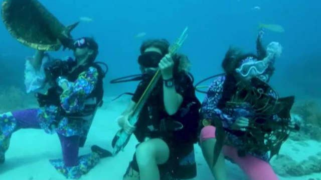 Divers hold underwater music festival in Florida Keys