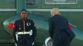 Commander-in-chief picks-up Marine's hat while at Joint Base Andrews