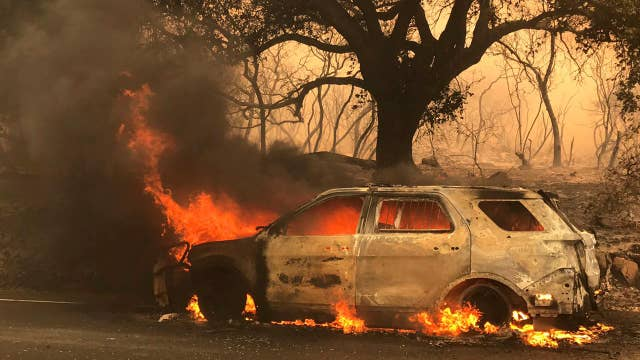 Record heat, dry weather fuel western wildfires