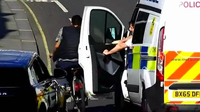 Cop uses car door to knock fleeing thief to ground