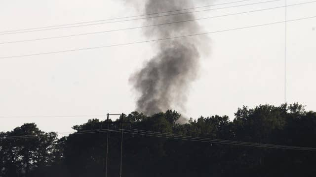 Officials try to determine what caused military plane crash
