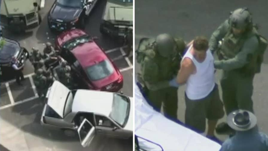 38-year-old suspect taken into custody by police in Massachusetts after reports of a man driving slowly through a Medford parking lot with several 'edged weapons'