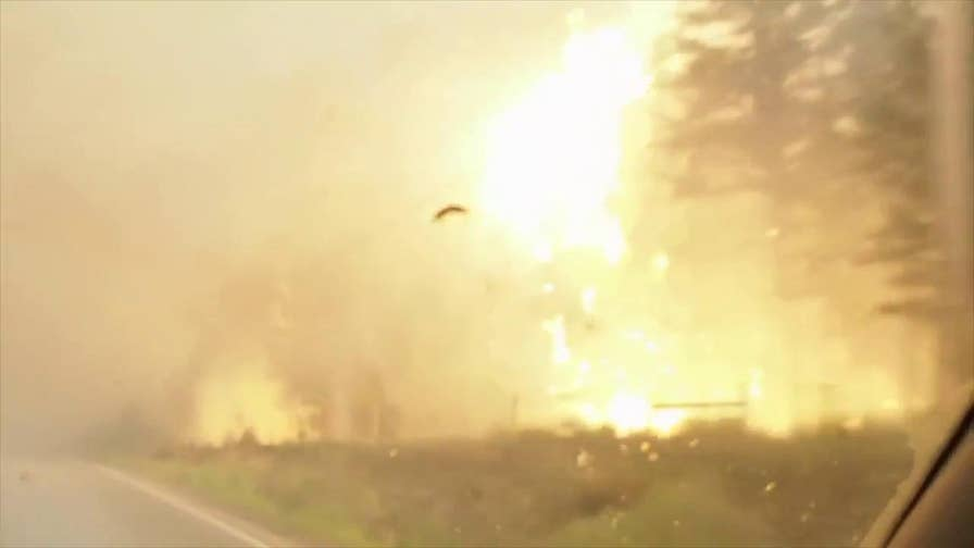 Raw video: Fire burns close to highway in British Columbia as residents evacuate