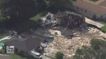 A massive sinkhole swallows two homes in Florida and the situation is still not under control