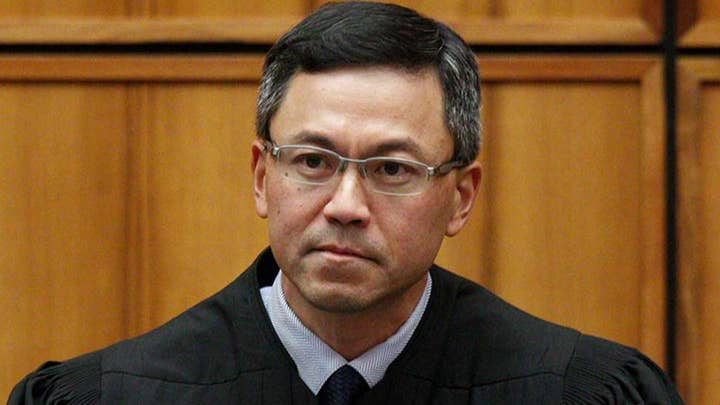 Hawaii judge expands travel ban exemptions