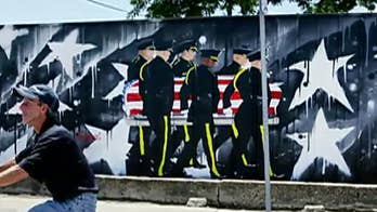 Outrage as Dallas officials threaten to tear down wall honoring fallen police officers because it 'runs afoul of regulations'