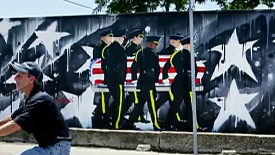 Business owner fights to keep mural to slain Dallas cops