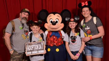 Disney World and Mickey Mouse help a family break the news to foster kids that they are finally getting adopted and the story goes viral. Photo courtesy: Courtney Gilmour