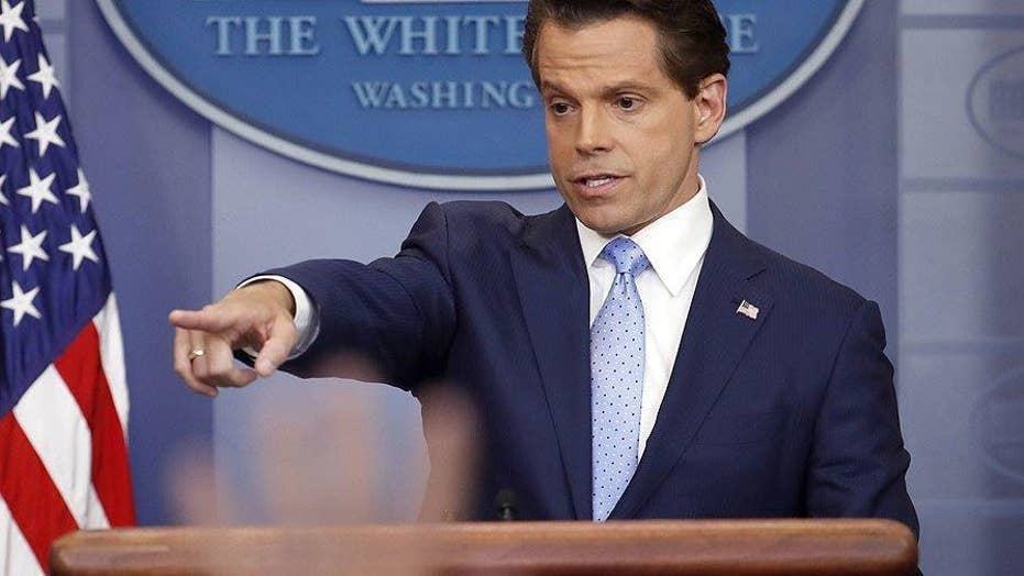Scaramucci's challenge as Spicer quits