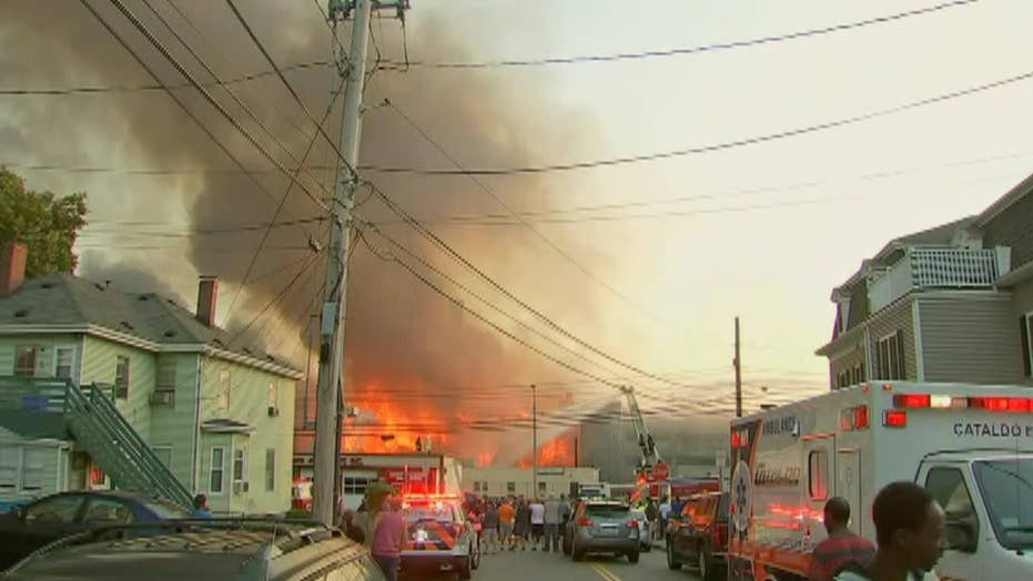 Massive fire blazes through apartment complex