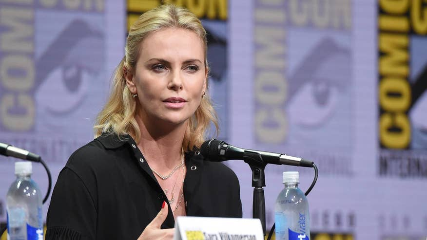 Charlize Theron spoke to fans at Comic-Con and addressed the Hollywood pay gap, her own pet peeves about female action star clichés and whether or not she'd be open to playing a female James Bond