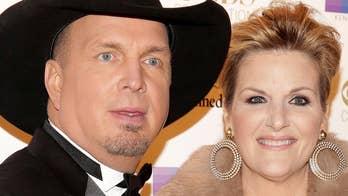 Garth Brooks debuts new love song to wife Trisha Yearwood at CMA Awards
