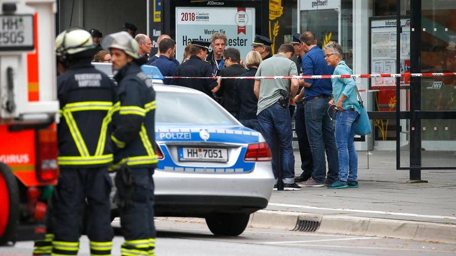 Incident occurred in a supermarket in northeastern Hamburg; police are searching for a motive