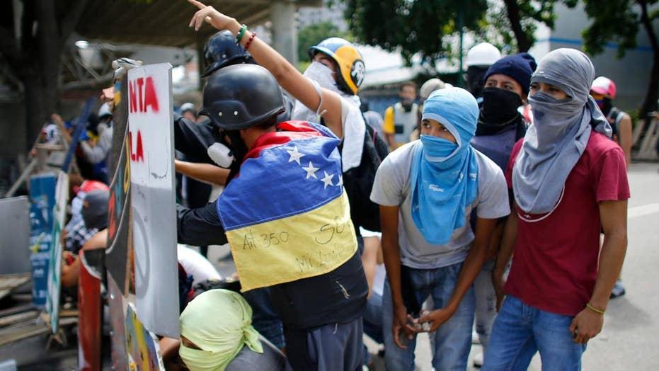 US orders Americans to leave Venezuela