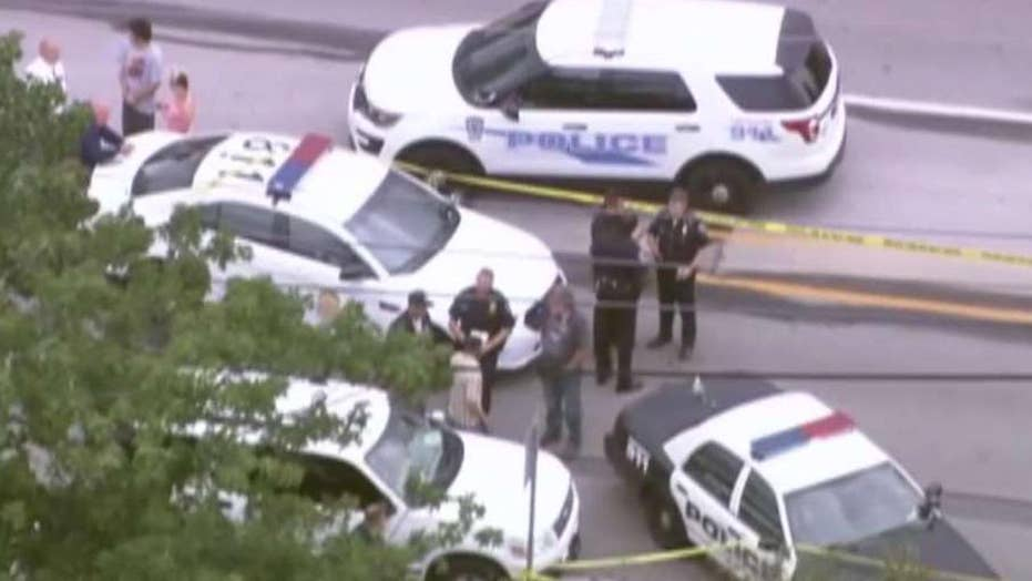 Indianapolis officer responds to car crash, is fatally shot