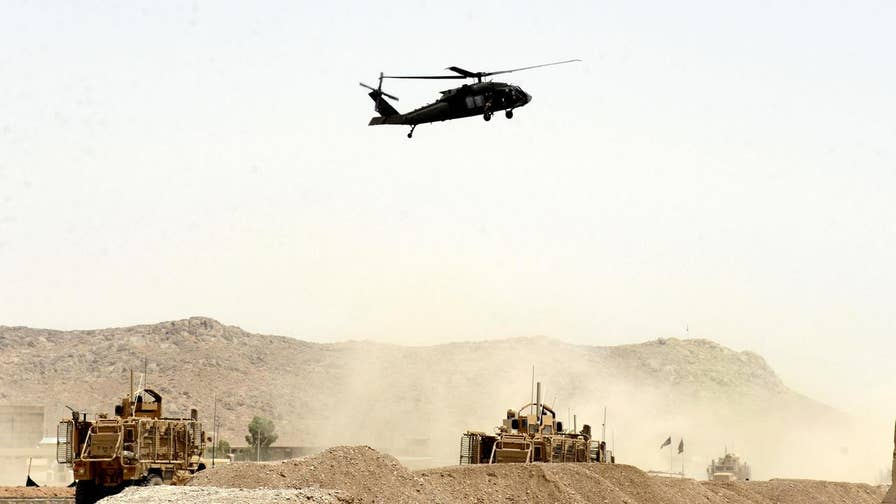 NATO convoy ambushed in Kandahar Province; Conor Powell reports