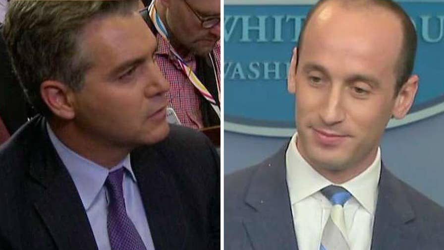 President Donald Trump's senior adviser for policy pushes back against CNN reporter's questions in the White House