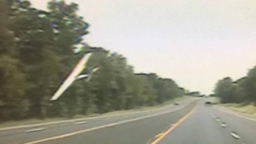 Raw video: Single-engine plane nose-dives onto Highway 69 between Mount Selman and Bullard