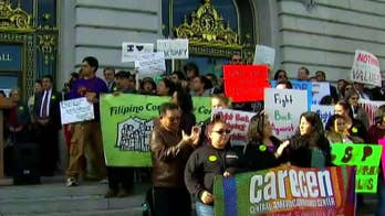 Debate over settlement for illegal immigrant who was arrested; Claudia Cowan reports