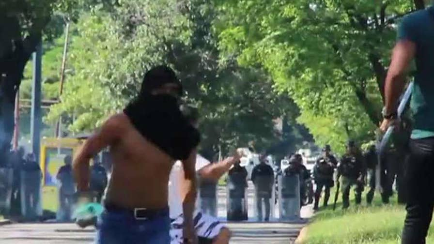 President Maduro vows 'maximum penalty' for band of anti-government fighters; Phil Keating reports from Miami