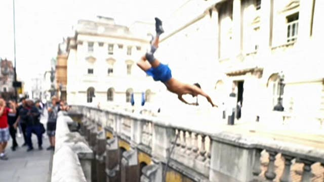 Daredevil somersaults over London's Somerset House gap