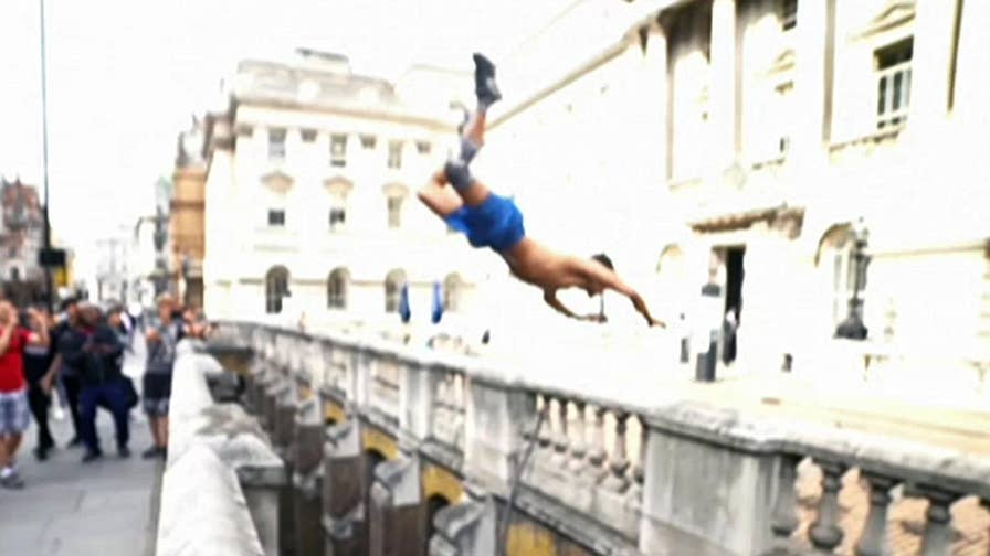 Daredevil Greg Ennis performs a wild somersault over a vast gap at London's Somerset House