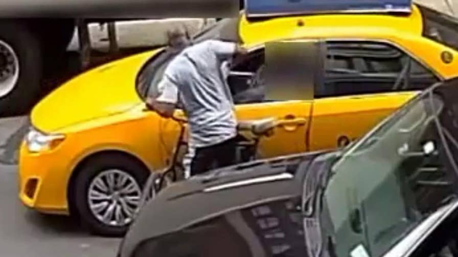 Raw video: New York City police release footage of suspect wanted for stealing money from drivers