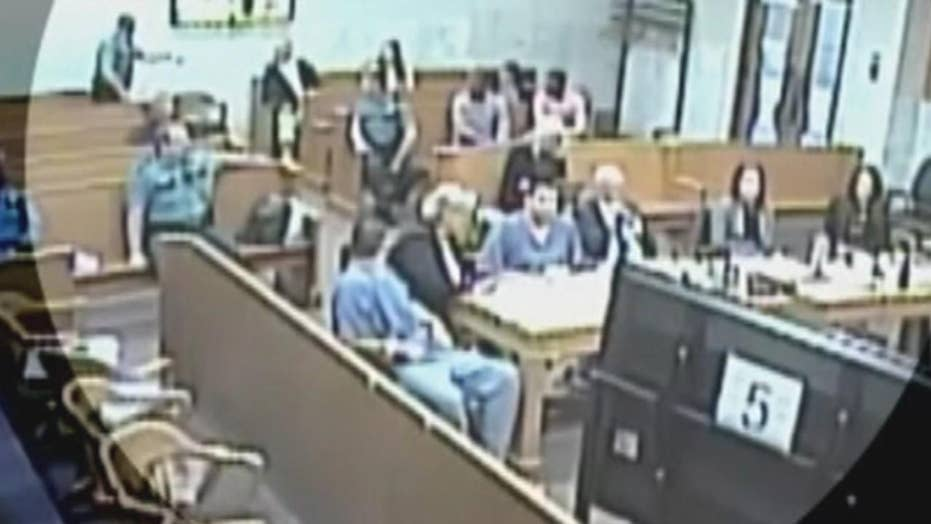 Man casually smokes joint in courthouse