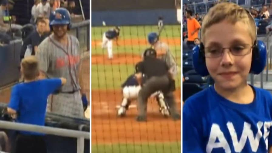 Raw video: Mother records dramatic interaction between her son and minor league baseball player