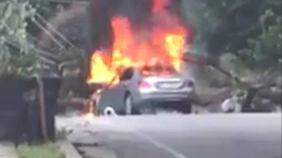 Man narrowly escapes burning car before it explodes