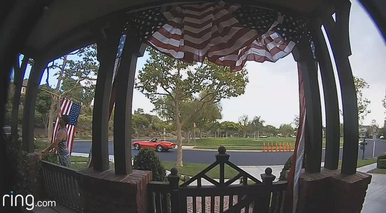 American flag picked up, re-positioned by Good Samaritan