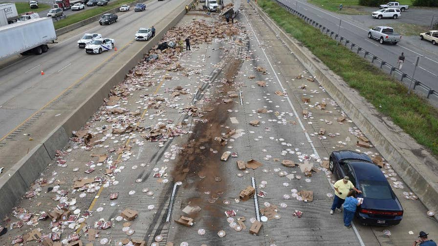 The trailer for a Tombstone and DiGiorno delivery truck was ripped open, spilling hundreds of frozen pizzas across a Little Rock, Arkansas highway