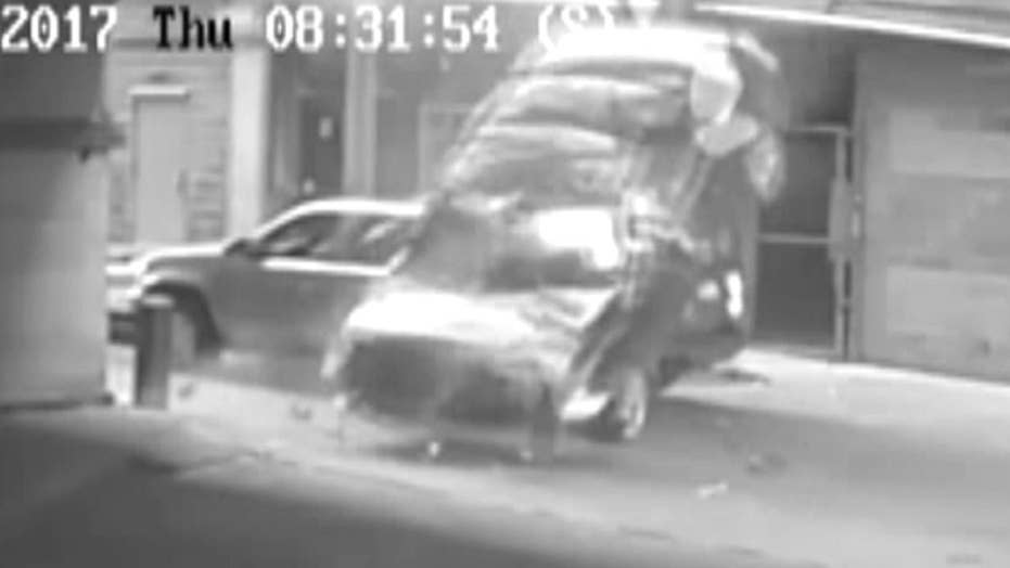 BMW falls seven stories off parking garage, hits SUV