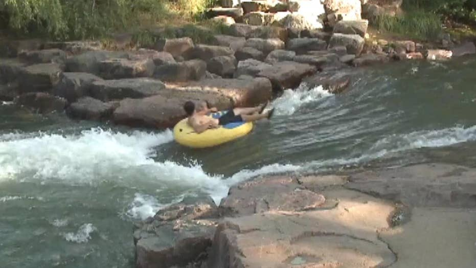 Denver woman dies trying to save son while tubing