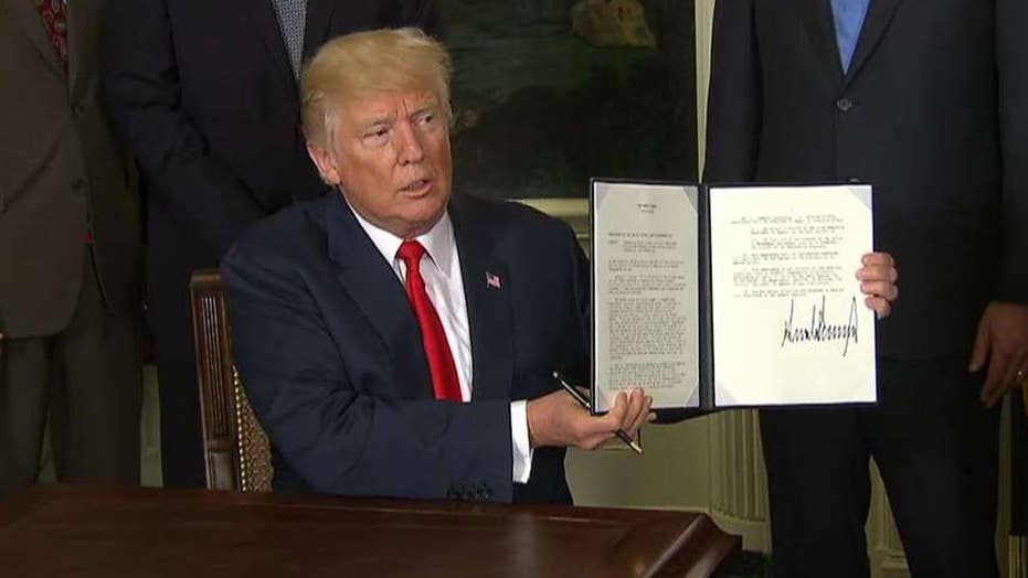 Trump signs measure to look into China's trade practices