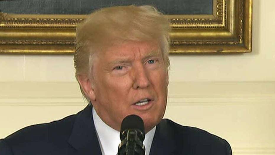 Trump condemns 'white supremacists' as DOJ opens probe
