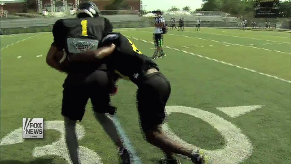 Football without tackling? High school implements 'thudding'