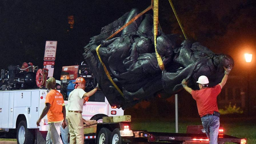 In the dead of night, Baltimore city contractors removed four Confederate statues honoring Robert E. Lee and Stonewall Jackson
