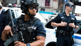 Heavily armed officers patrolling Times Square