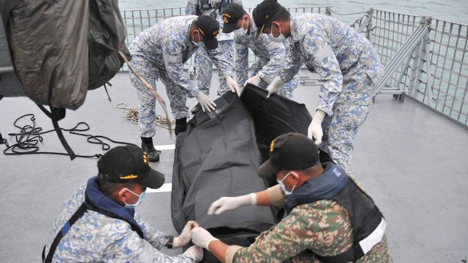 Divers discover remains of Navy sailors on USS McCain