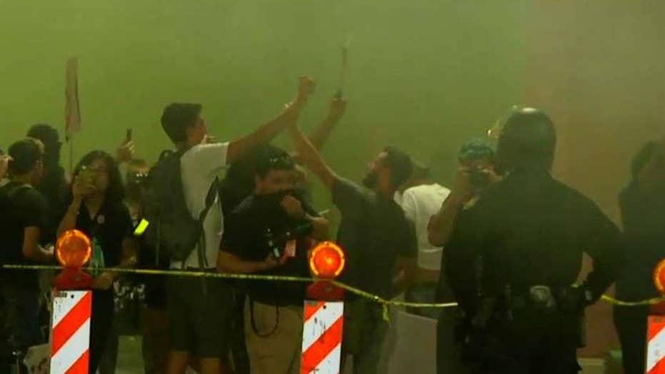 Police use smoke to disperse anti-Trump protesters