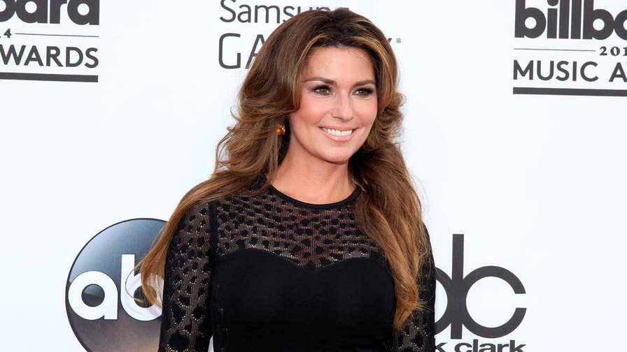 Fox411: Shania Twain revealed the reason she name-dropped Brad Pitt on her single 'That Don't Impress Me Much' was because she didn't see what the big deal was after seeing naked photos of him